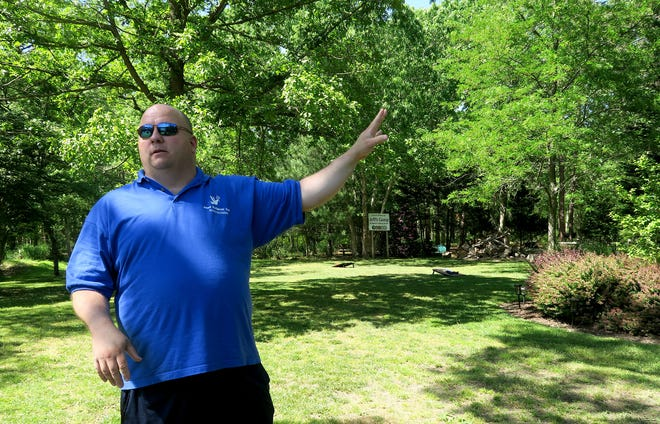 Paul Hulse, co-founder and president of Just Believe Inc, a charity that helps people experiencing homelessness, explains plans for some of the land along Route 72 in Barnegat Thursday, May 27, 2021, that Marty Weber is donating to the group.  In memory of Weber's deceased partner of 30 years, Jeff Poissant, part of the land will house a homeless living center will be built in honor of Poissant and be known as Camp Jeff.