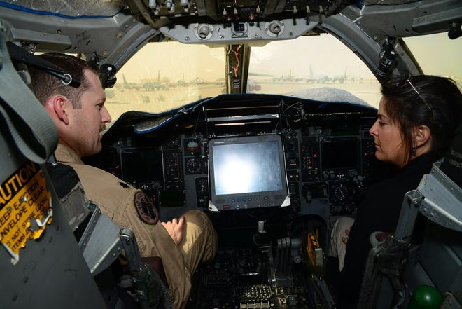 Joseph Kramer, then a Lt. Col. with the 34th Expeditionary Bomb Squadron commander, shows U.S. Ambassador Dana Shell Smith the inside of a cockpit of a B-1B Lancer on April 27, 2015, at Al Udeid Air Base, Qatar. Now a colonel, Kramer will be the new Dyess AFB and 7th Bomb Wing commander.
