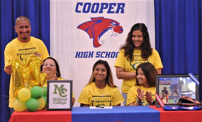 Cooper senior Angelic Gonzalez, seated center, will play softball at Midland College in the fall.