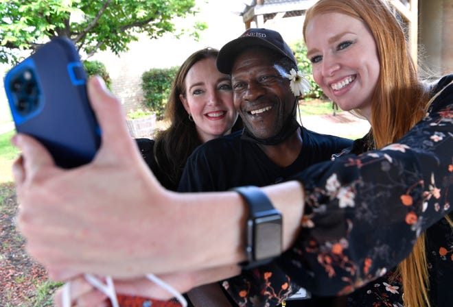 Chris Halifax (left) and Melissa Scott take a selfie with Reagan Elementary School custodian Ray Medlock on the last day at the west Abilnee campus Thursday. Both women started as teachers at Reagan. Halifax served as principal there while Scott currently is principal at Lee Elementary School. Students from Reagan will be attending other schools next year when AISD repurposes the 62-year-old campus.
