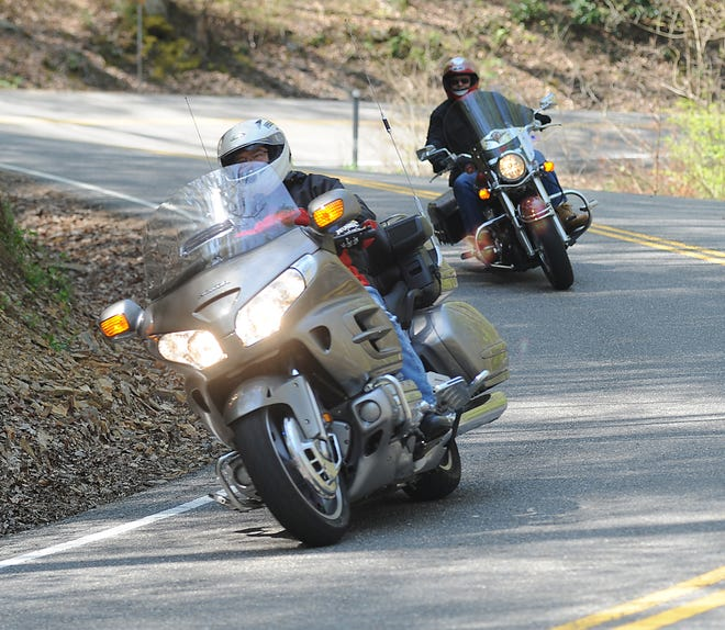 Motorcyclists cruise a portion of U.S. 129 near Robbinsville, known as the Tail of the Dragon, in this 2010 photo