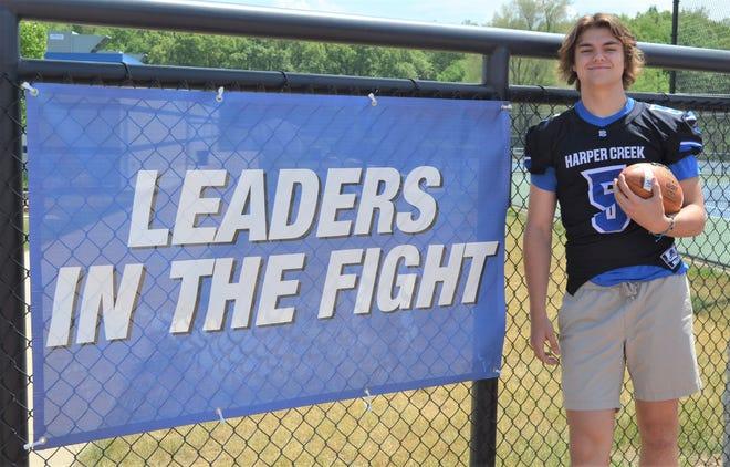 Harper Creek three-sport standout Ben Shafer was recently presented a student-athlete national leadership award.