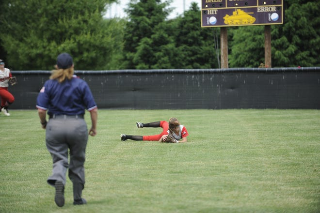 Mustangs' Maddison Kearny diving to make an out against Ironton.