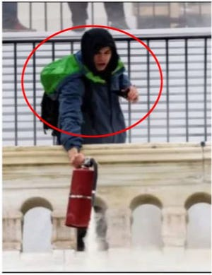U.S. District Court for the District of Columbia court records show images of a man prosecutors say is Nicholas James Brockhoff of Covington at the U.S. Capitol dousing officers with a fire extinguisher on Jan. 6, 2021.