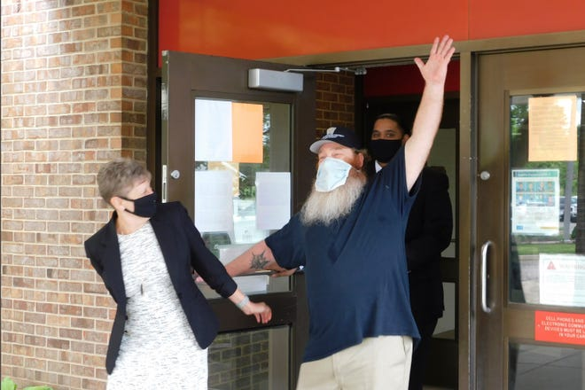 Gilbert Poole Jr., right, accompanied by attorney Marla Mitchell-Cichon, leaves prison in Jackson, Mich., Wednesday, May 26, 2021, after being exonerated of first-degree murder in Oakland County. Poole spent 32 years in prison. Authorities said he was wrongly convicted with unreliable evidence.