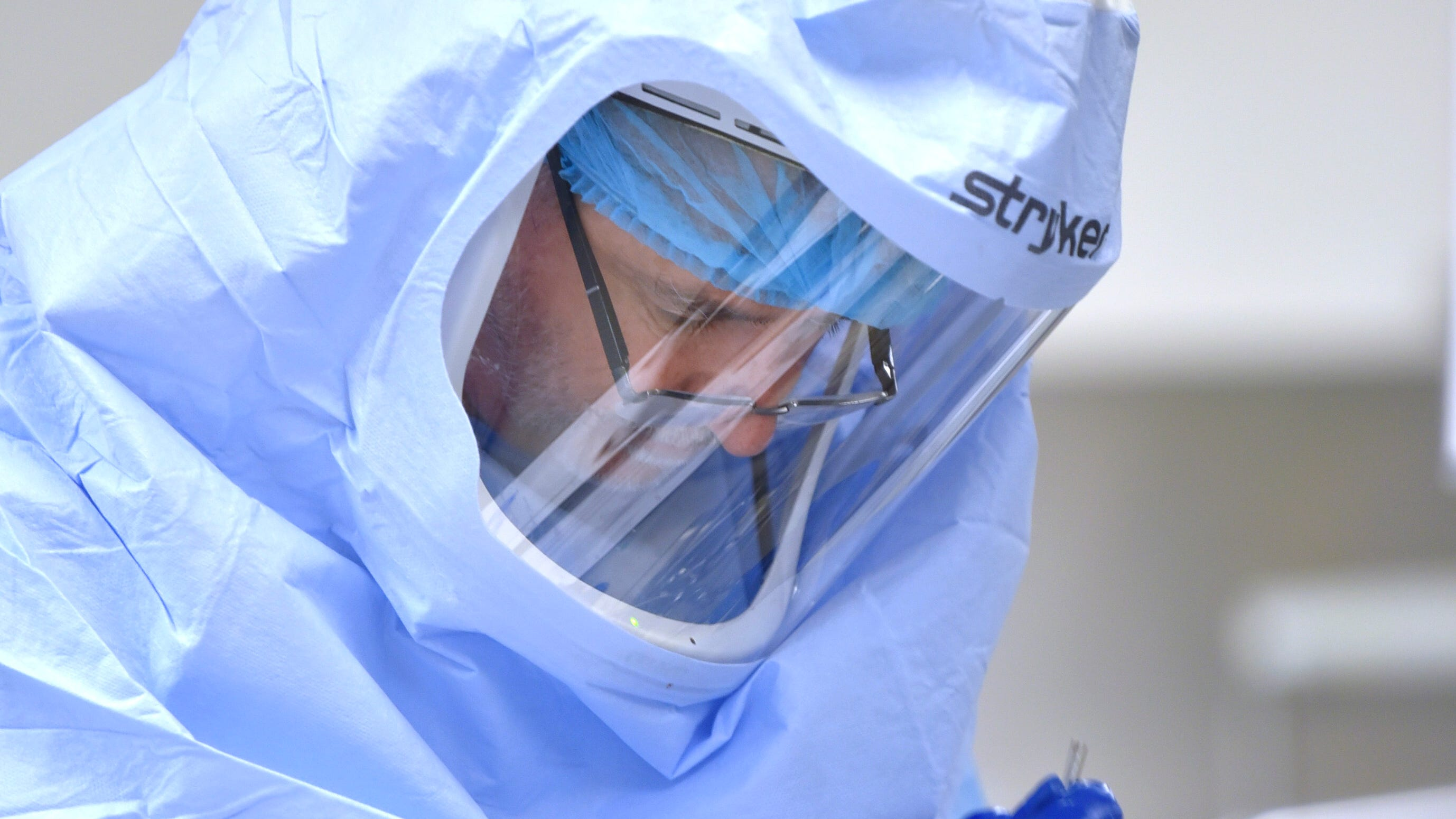 Beaumont Health instrument technician Michael Victor wears complete personal protection equipment while he decontaminates surgical instruments before they are mechanically washed and sterilized. Beaumont and other hospitals are filling staff shortages.