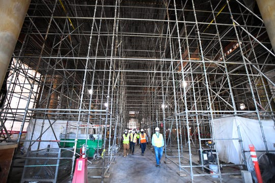 This is the inside of the Michigan Central train station with scaffolding filling the main room.