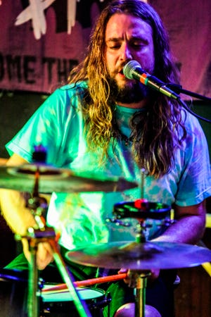 Kevin Clark plays drums as Jess Bess & The Intentions performs at a bar in Highwood, Ill., May 22, 2021.