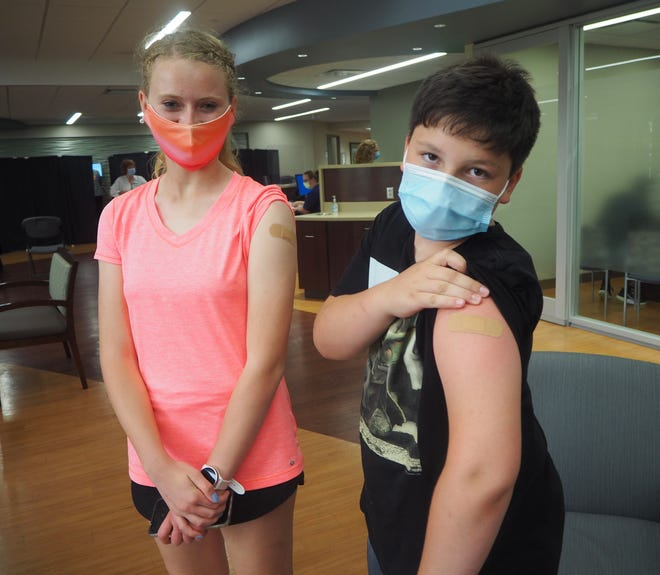 Tannah Bowser, 17, and Canaan Bowser, 12, a sister and brother from Fremont, got vaccinated Wednesday at ProMedica Memorial Hospital COVID-19 vaccination clinic.