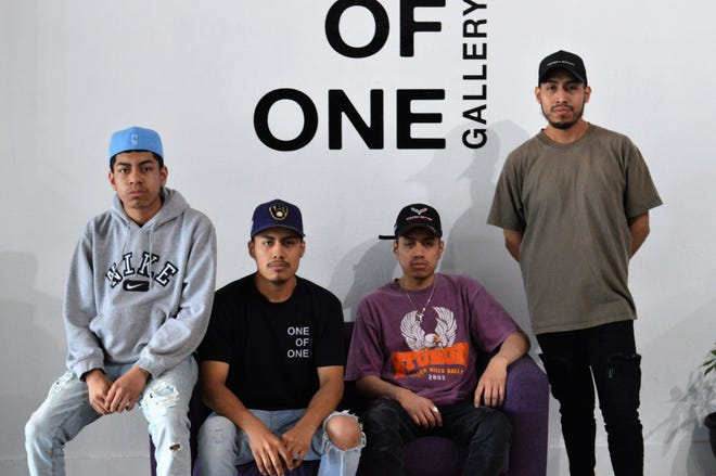 Four brothers (pictured left to right) Hector De Jesus Martinez (17), Eduardo De Jesus Martinez (19), Eric De Jesus Martinez (21) and Abimael De Jesus Marinez (25), opened One of One Gallery in De Pere. The three elder brothers share ownership of the shop.