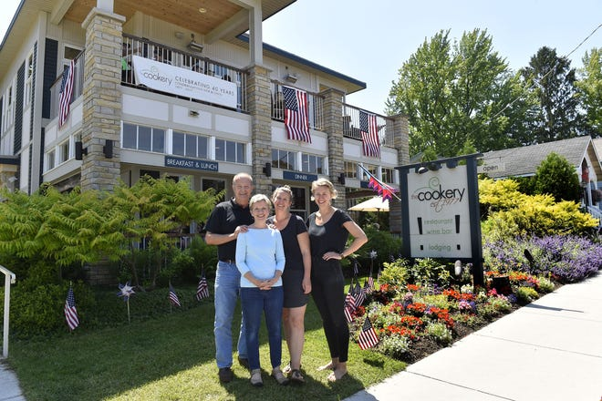 Dick and Carol Skare, left, are retiring and closing The Cookery after 44 years of business. Joining them in this 2017 photo are their  daughters Courtney and Karin Skare, who previously managed the Fish Creek establishment.