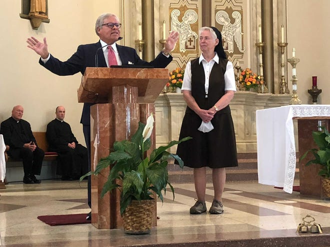 Sister M. Lenore Schwartz, right, assigned to St. Boniface Catholic Church in Lafayette since 2000, became the latest in the area to be presented the Sagamore of the Wabash, Indiana's highest citizen award. State Sen. Ron Alting presented the award.