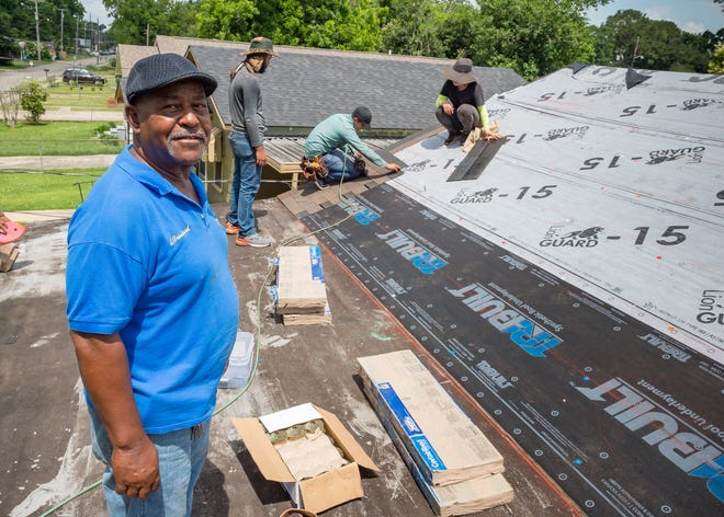 Elroy Broussard with the Knights of Peter Claver helps to repair Nellie Dean's roof, which was destroyed in Hurricane Delta. The Knights of Peter Claver #166, Sun Chdo, CJ Roofing, ABC Roofing and Friends repaired Dean's roof on Thursday, May 27, 2021.