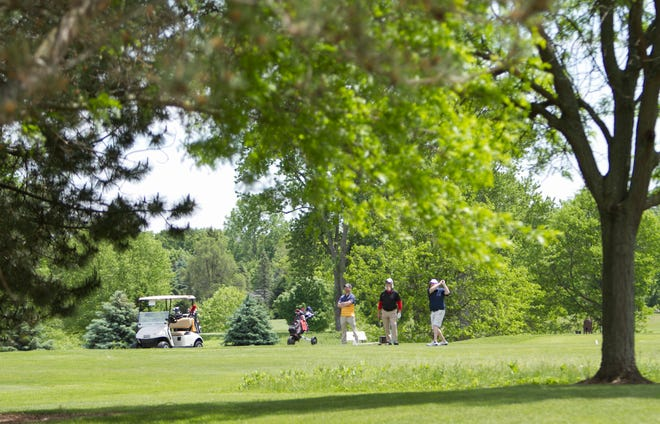 A group of golfers take advantage of a sunny spring day to get in a round of golf at Huron Meadows Metropark in Green Oak Township Thursday, May 27, 2021.