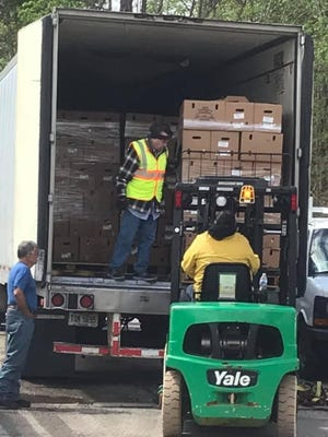 David Morgenstern of Lexington, standing inside the back of the semi truck, said truckloads of free food will be available to anyone in need Saturday and Sunday starting at 9 a.m. at 1015 Koogle Road.