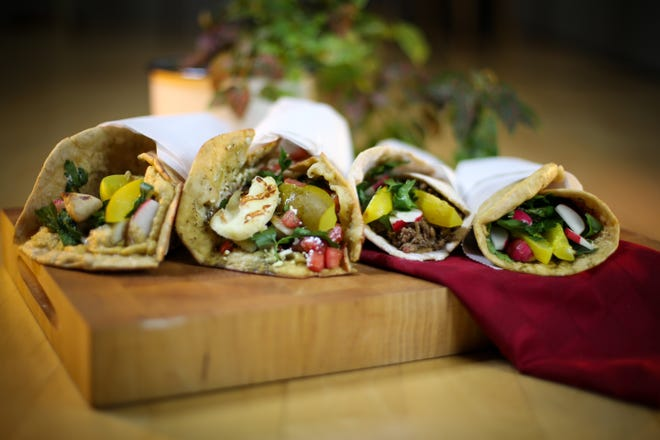 Middle East Side, a pop-up restaurant operating at lunchtime out of Amilinda, 315 E. Wisconsin Ave., focuses on Middle Eastern flavor for its flatbread sandwiches and other street food. It currently sells four kinds, roasted eggplant, ground beef, chicken, and cheese.