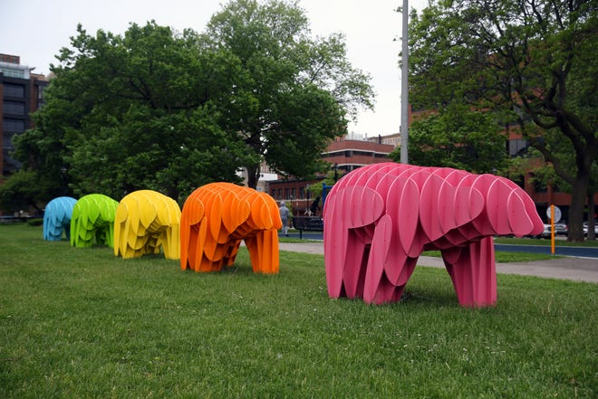 The Massimals MKE bears that were white in winter now represent the rainbow colors as seen on May 27 at Cathedral Park in downtown Milwaukee. The Downtown business district is introducing art to the downtown area as a way to jump-start the economy.