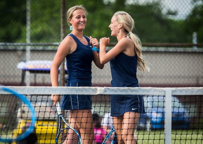 Delta's Tynan Dishman and Maggie Manor compete in their doubles regional match at Marion High School Wednesday, May 26, 2021.