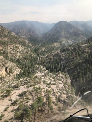 A view of the Johnson Fire, burning in the Gila National Forest, north of Hells Hole looking south Tuesday, May 25, 2021.