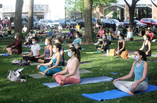 An estimated 220 people congregated in Plymouth's Kellogg Park for the first Hines Park Lincoln Wednesday Night Workout since before the COVID-19 pandemic hit in March of 2020.