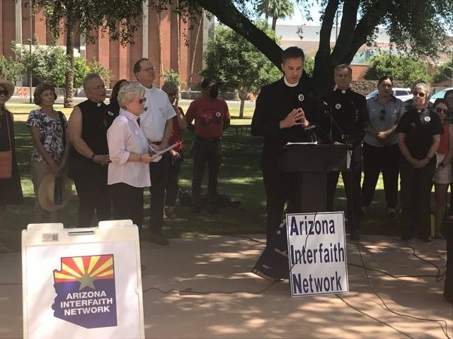 The Rev. Hunter Ruffin speaks at a press conference by the Arizona Interfaith Network held outside of the Arizona state capitol on Thursday, May 27, 2021.