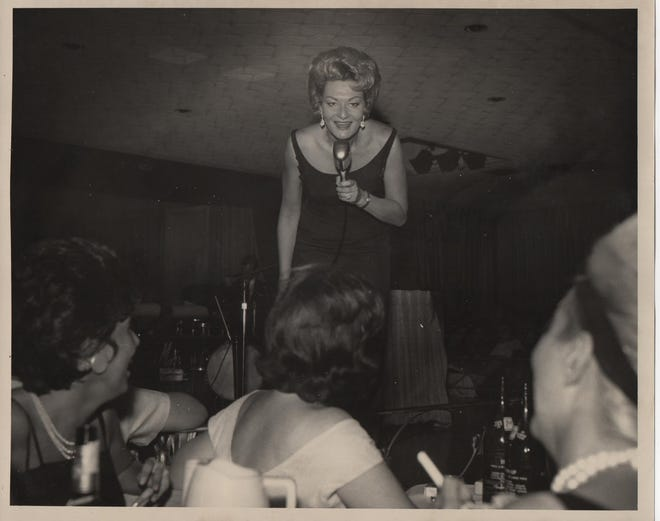 Comedian Rusty Warren, a pioneer comedian with a string of gold-selling albums in the 1960s, appears on stage at the Club Alamo in Detroit in this undated photo