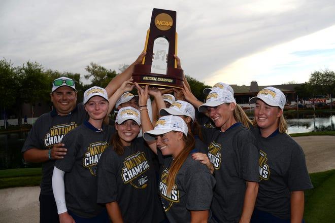 Ole Miss golfers celebrate after winning the NCAA Women's Golf Championship at Grayhawk Golf Club in Scottsdale, Ariz.