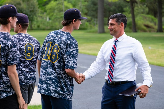 St. Clair County Assistant Prosecuting Attorney Joshua Sparling, right, shakes hands with members of the Port Huron Northern baseball team after their annual run in honor of Memorial Day Wednesday, May 26, 2021, at Allied Veteran's Cemetery in Port Huron.