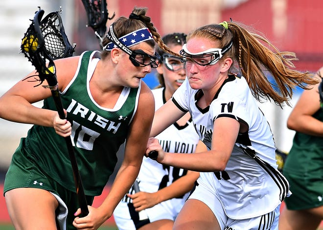 York Catholic's Sydney Mentzer, seen here in a file photo at left, has been named a Central Pennsylvania Girls' Lacrosse All-American.