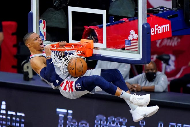 Washington Wizards' Russell Westbrook reacts as he dunks the ball during the first half of Game 2 in a first-round NBA basketball playoff series against the Philadelphia 76ers, Wednesday, May 26, 2021, in Philadelphia. Westbrook is not happy about the way he was treated by a Philadelphia fan who threw popcorn on him. (AP Photo/Matt Slocum)