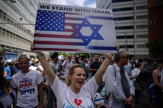 Pro-Israel demonstrators attend a rally denouncing antisemitism and antisemitic attacks, in lower Manhattan, New York on Sunday, May 23, 2021. (Ed Jones/AFP/Getty Images/TNS)