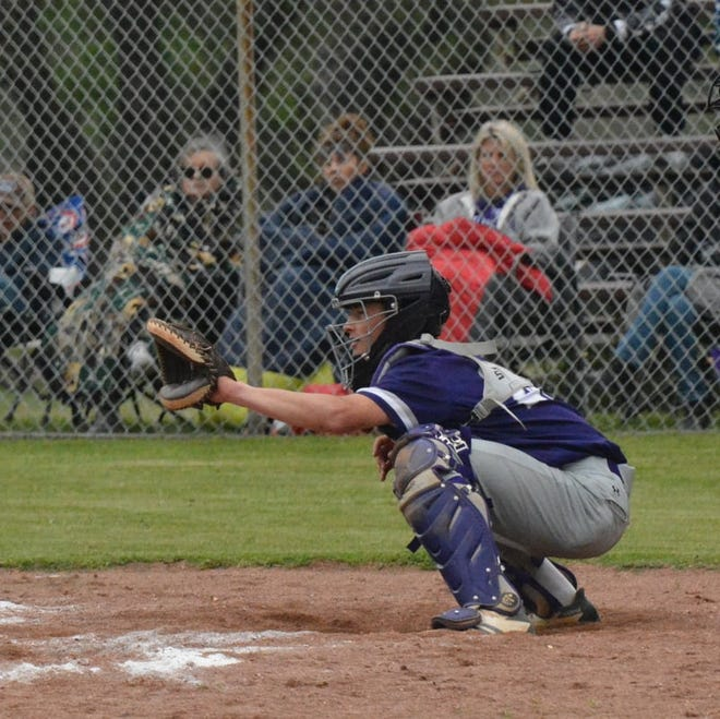 Mason High School's Wyatt Row catches for the Punchers during a baseball game in the 2021 season.