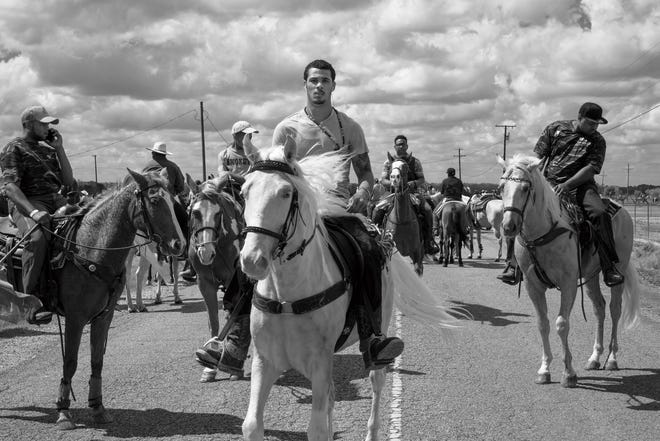 """Jeremiah Ariaz's """"Louisiana Trail Riders"""" exhibition documents the Black cowboy culture through photographs. The exhibition runs June 12 through August 7 at Artspace in Shreveport. Pictured: Homer (center) and Riders, (Jeanerette) 2015"""