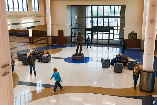 Travelers walk through the lobby on Thursday, May 27, 2021 at the Sioux Falls Regional Airport.