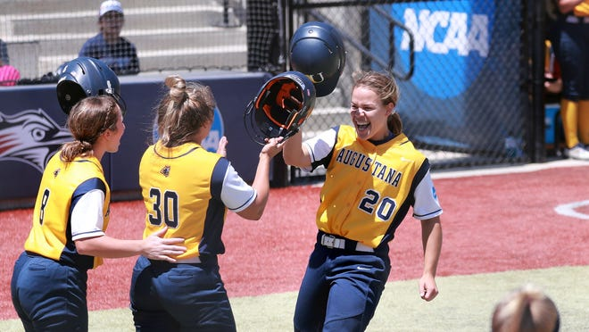 Kendall Corneck (20) celebrates with teammates Thursday in Denver at the NCAA Division II softball championships.
