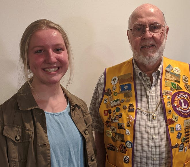 Tom Earley (right), President of the Dell Rapids Lions Club, and Dells High School senior Kathryn Fletcher. Fletcher is the recipient of the 2021 Lions Club scholarship.