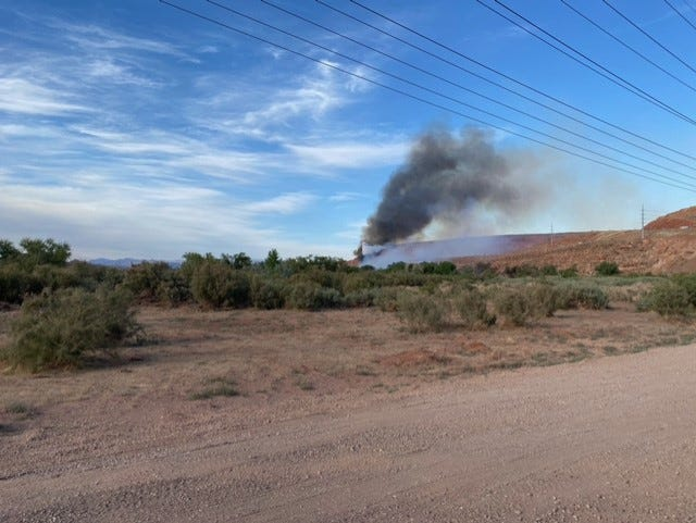 A brush fire burns in the Warner Draw area east of the Southern Parkway in Washington City on Wednesday, May 26, 2021.