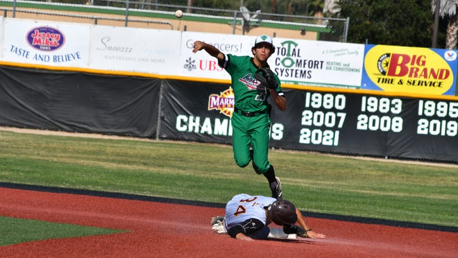 Max Muncy fires to first base to complete a double play during Thousand Oaks High's 8-3 win over Simi Valley in a nonleague game on Wednesday. The Lancers finished the regular season with a 24-1 record.