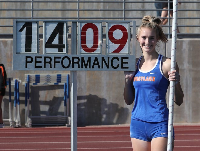 Paige Sommers poses by her record-setting mark in the pole vault at the Marmonte League track and field championships on Wednesday.
