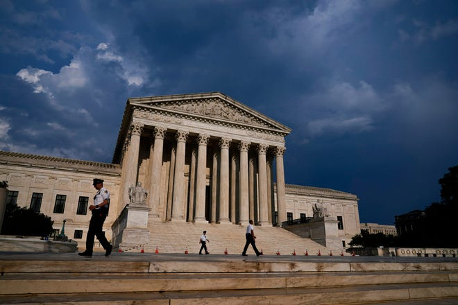 The Supreme Court is seen under threatening skies following a storm in Washington, Wednesday, May 26, 2021. (AP Photo/J. Scott Applewhite) ORG XMIT: DCSA180