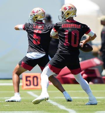 San Francisco 49ers quarterbacks Trey Lance (5) and Jimmy Garoppolo (10) throw the football during OTAs on May 25.