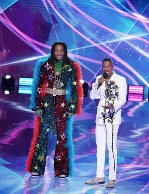 """(L-R) Wiz Khalifa and host Nick Cannon in """"The Masked Singer"""" finale."""