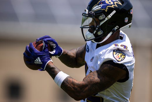 Baltimore Ravens wide receiver Rashod Bateman catches a pass during an OTA at Under Armour Performance Center on May 26.