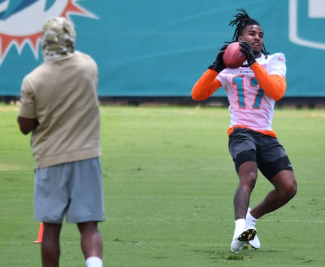 Miami Dolphins receiver Jaylen Waddle participates in OTA workouts at Baptist Health Training Facility on May 26.