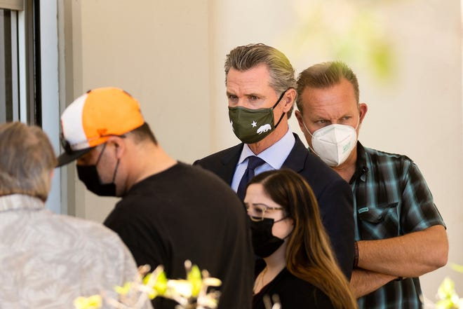 California Gov. Gavin Newsom leaves a staging area for Santa Clara Valley Transportation Authority (VTA) workers, family members and officials following a shooting at one of the agency's rail yards on Wednesday, May 26, 2021, in San Jose, Calif.