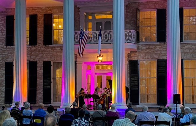 The Schumann Chamber Players perform at the historic Neill-Cochran House Museum lawn. The in-person performances of the Austin Chamber Music Festival will continue there, but they are available online, as well.