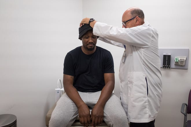 A patient is shown in 2019 getting care at the People's Community Clinic, where a third of the adult patients do not have health insurance.