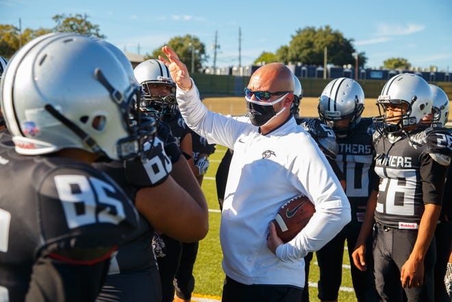 Eastside Memorial head coach Luis Becerra consoles his team after a loss against the San Antonio YMLA Lions last season at Nelson Field. Faced with low participation rates by upperclassmen, Eastside Memorial will not field a varsity football team in 2021.