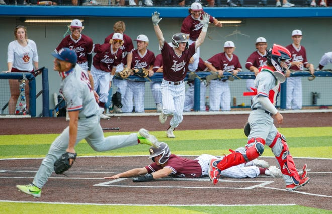 Dripping Springs' Luke Hudson slides across home plate with the winning run against Corpus Christi Veterans Memorial in game one of a Class 5A Region IV semifinal series Thursday at North East Stadium in San Antonio. The Tigers won 3-2 in nine innings.