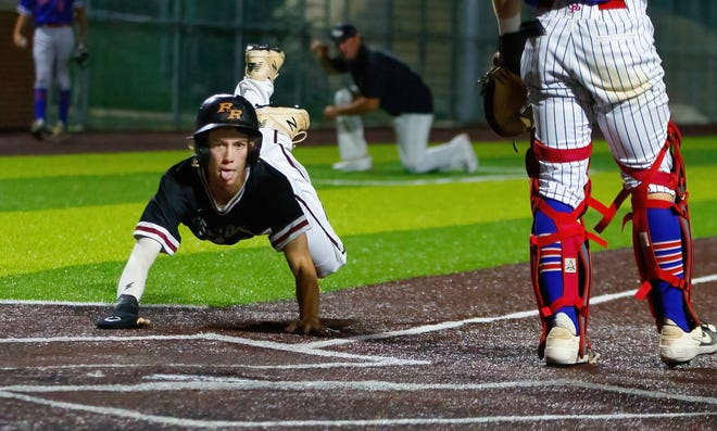 Rouse's Samuel Walsh dives across home plate in the seventh inning of his team's 3-1 victory Thursday.
